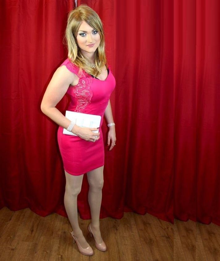 Crossdresser in pink dress