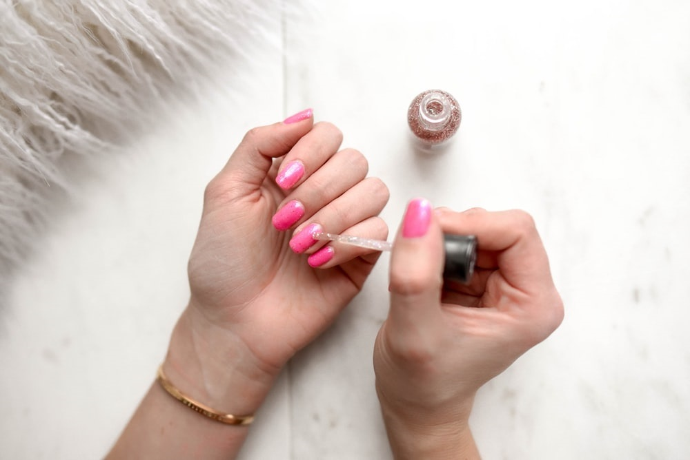 putting-on-nail-polish