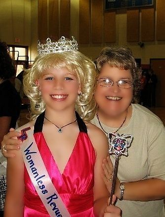 Boy dressed as girl in womanless beauty pageant