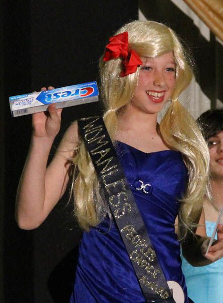 Boy dressed as girls in womanless beauty pageant