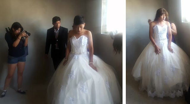 Transformation into bride - putting the wedding dress