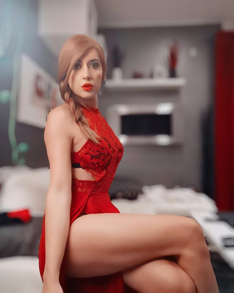 Crossdresser Melania in red dress