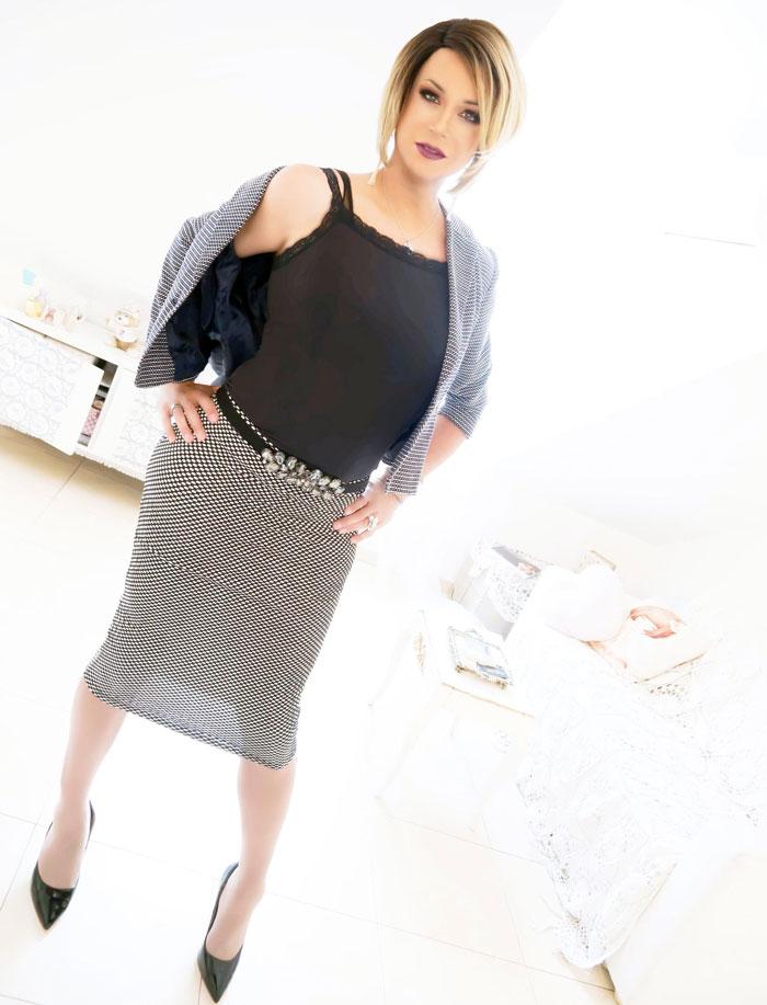 Maica Mara crossdressing in skirt and heels