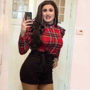 Carmen Michaels crossdressing in black skirt