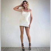 Crossdresser Svetlana in white mini dress and heels