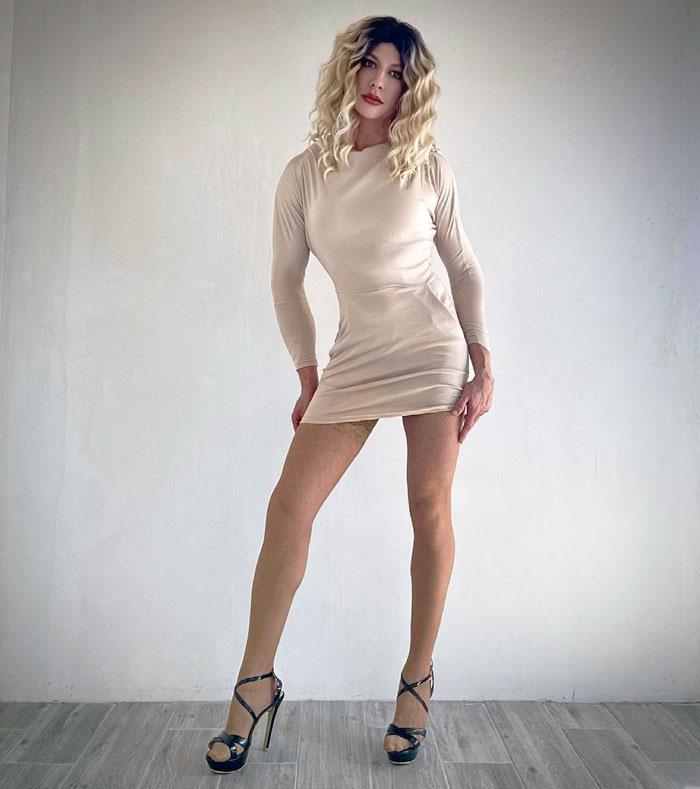 Svetlana crossdressing in white bodycon dress