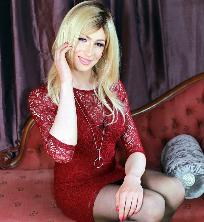 Catherine crossdressing in red dress and stockings