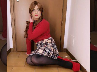Crossdresser Jennifer in plaid skirt and high heels