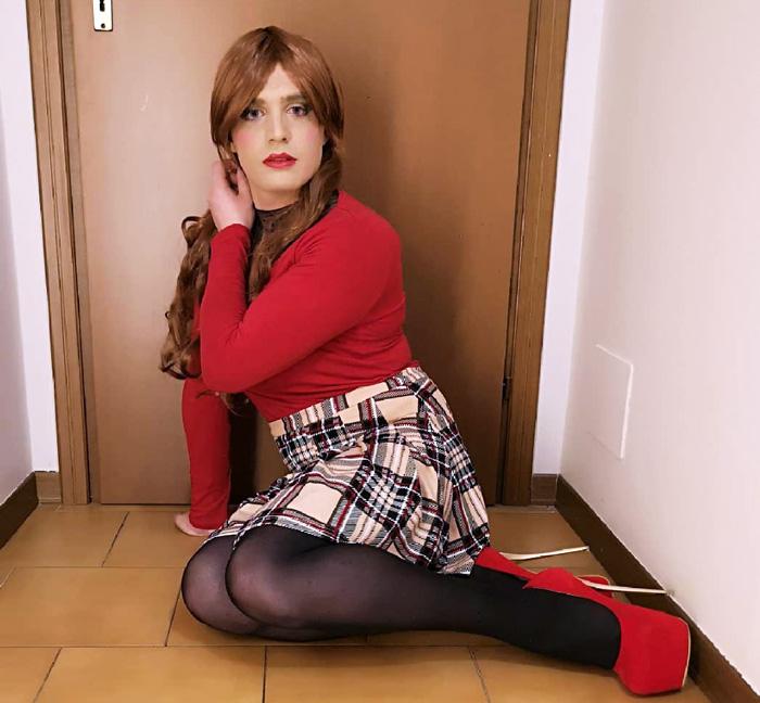 Beautiful crossdresser Jennifer in mini skirt and heels