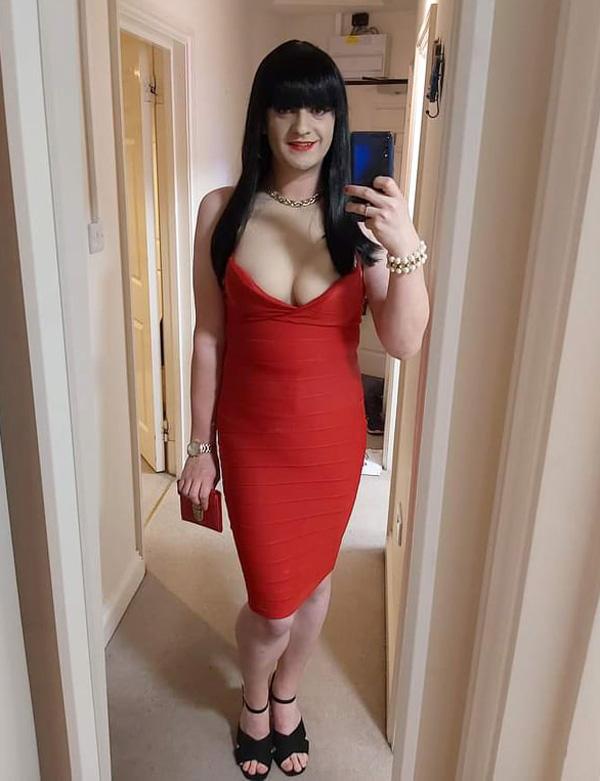 Jessica Kelly crossdressing in red bodycon dress