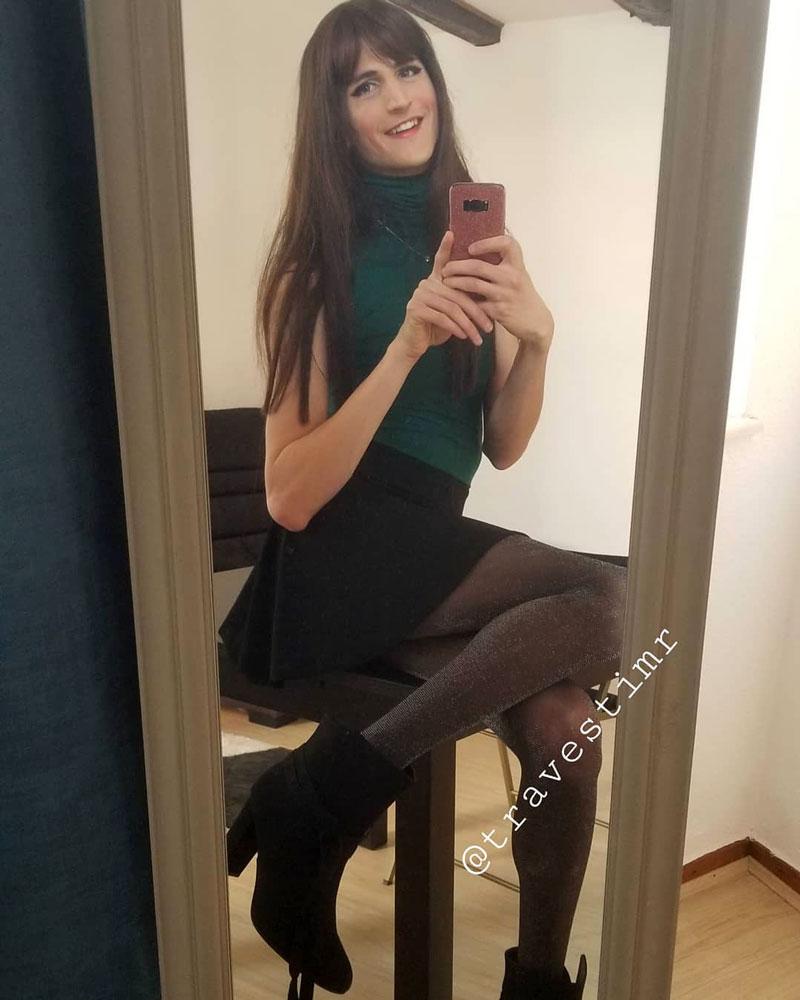 NIna crossdressing in cute skirt and heels