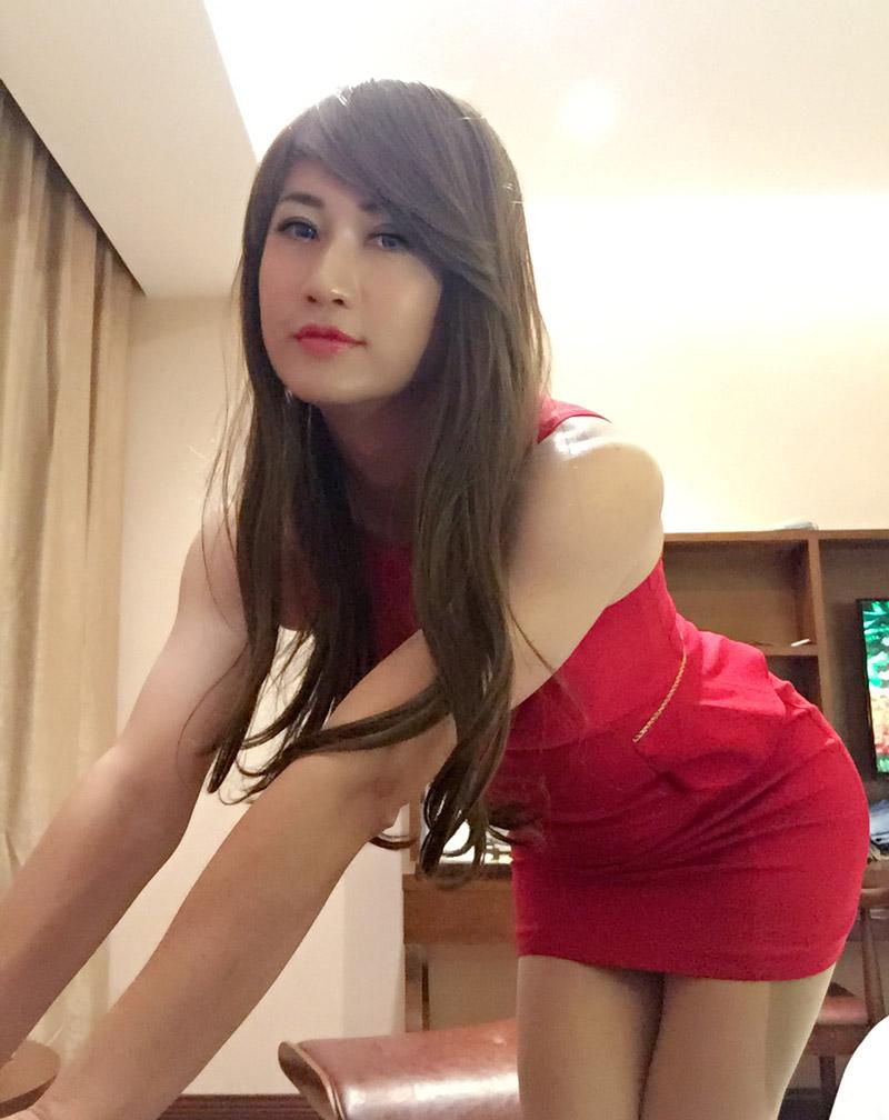 Beautiful crossdresser Sonye Chen in red dress