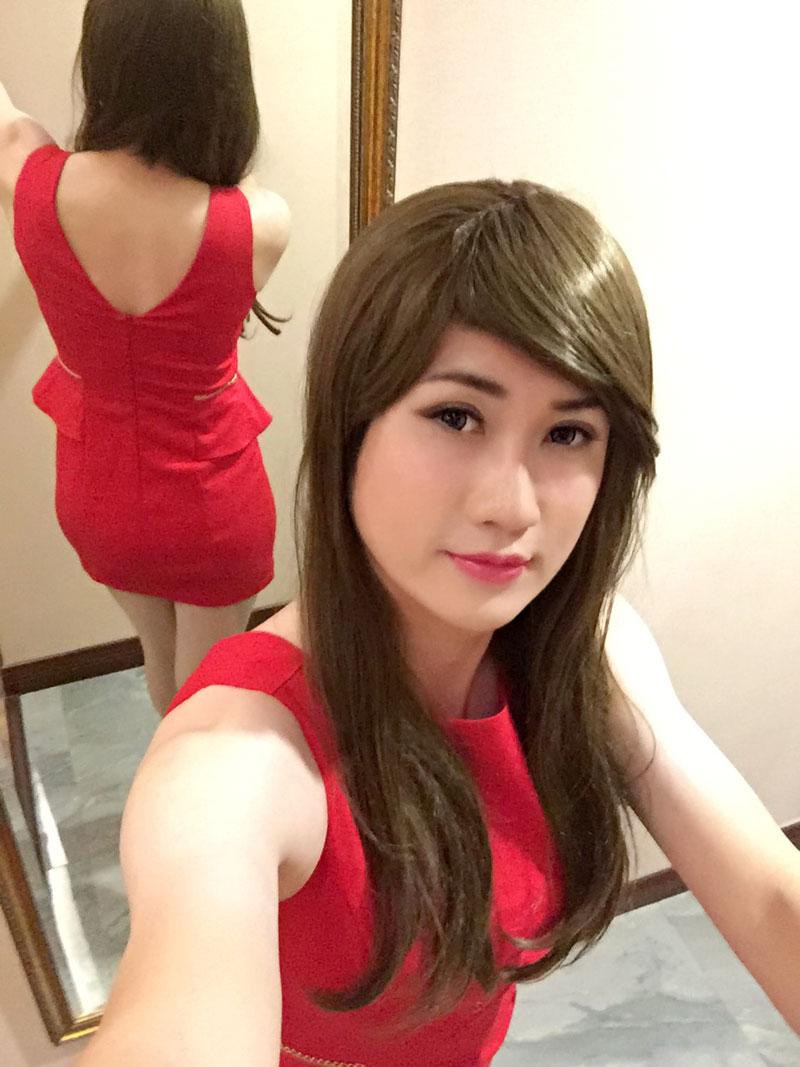 Sonye dressed as woman in red dress